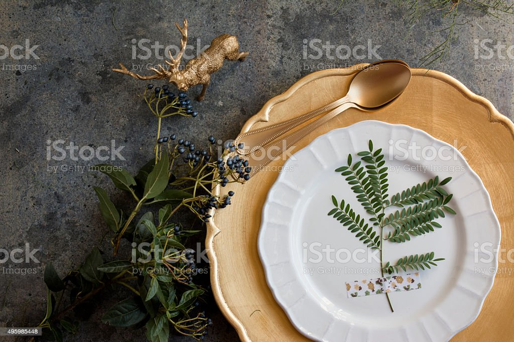 Holiday Gold place setting, napkin brown plaid, on grunge backgr stock photo