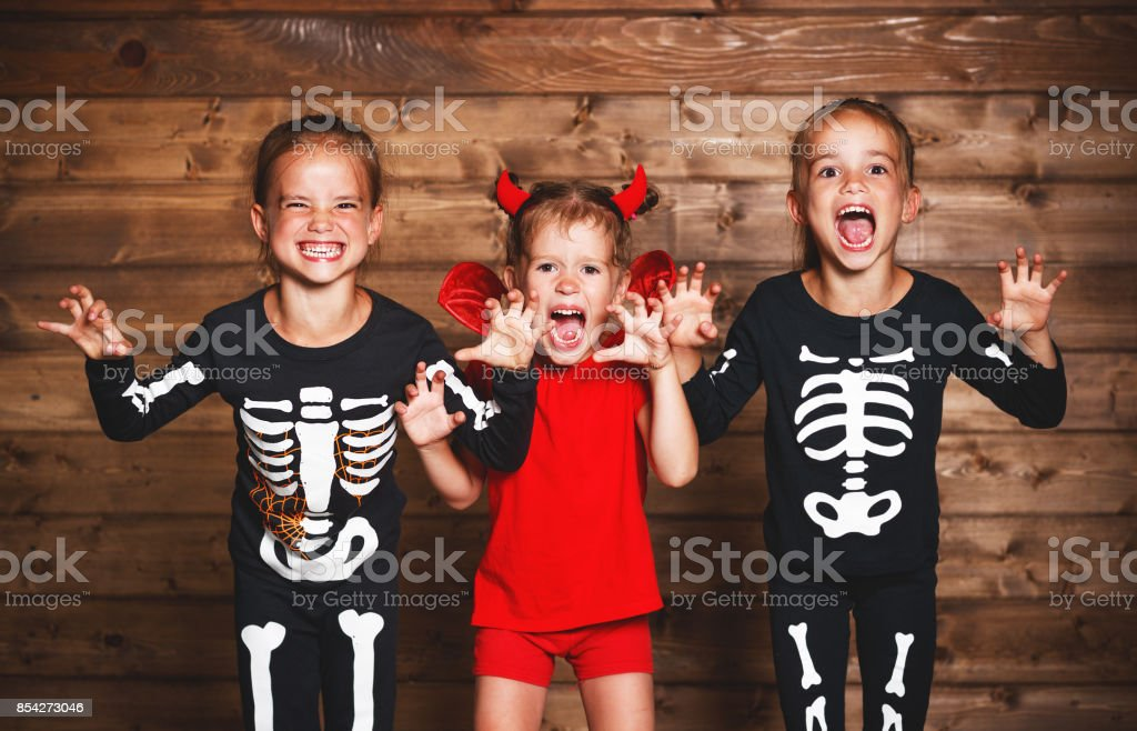 holiday halloween. Funny group children in carnival costumes on a...