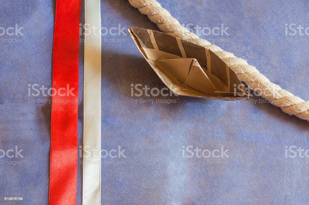 USA holiday, happy Columbus day paper boat on blue background stock photo