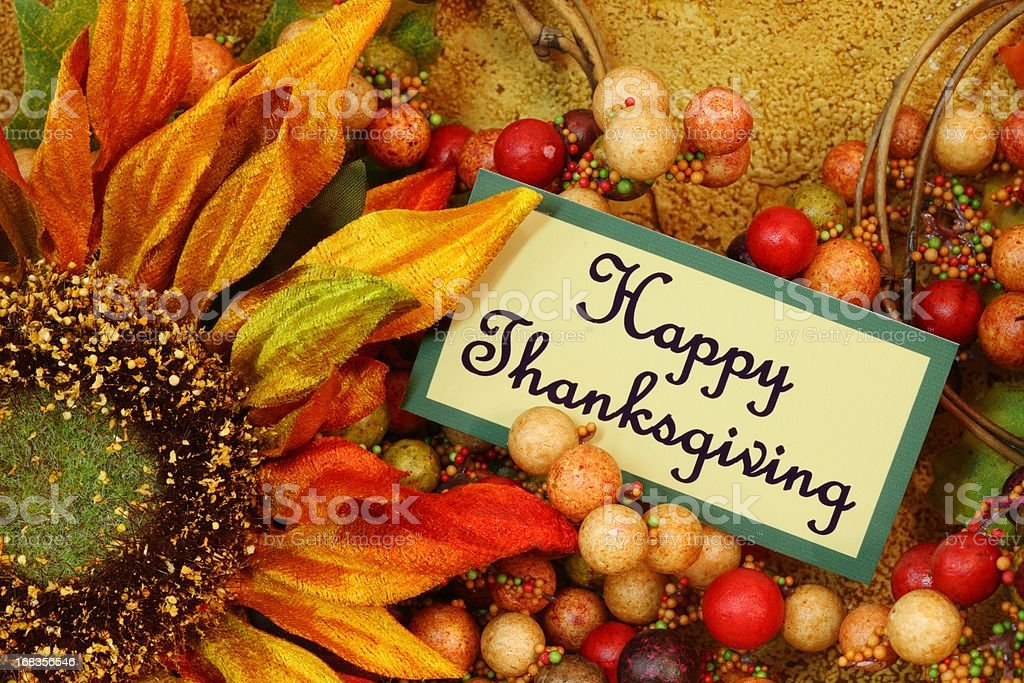 Holiday: Happy Thanksgiving on tag with sunflower Still Life royalty-free stock photo