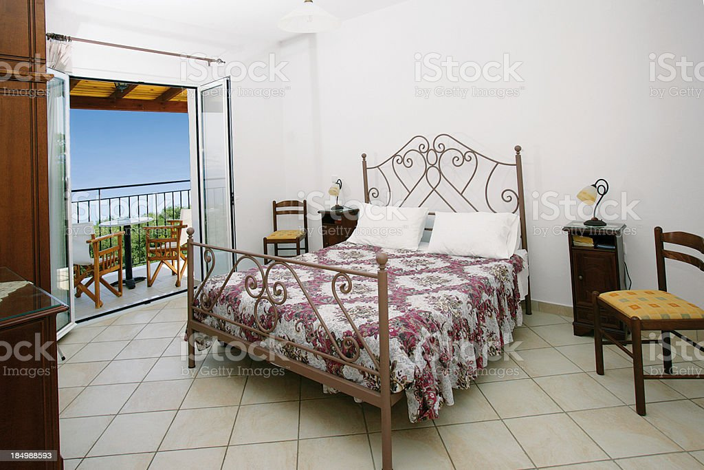 Holiday hotel bedroom and balcony royalty-free stock photo