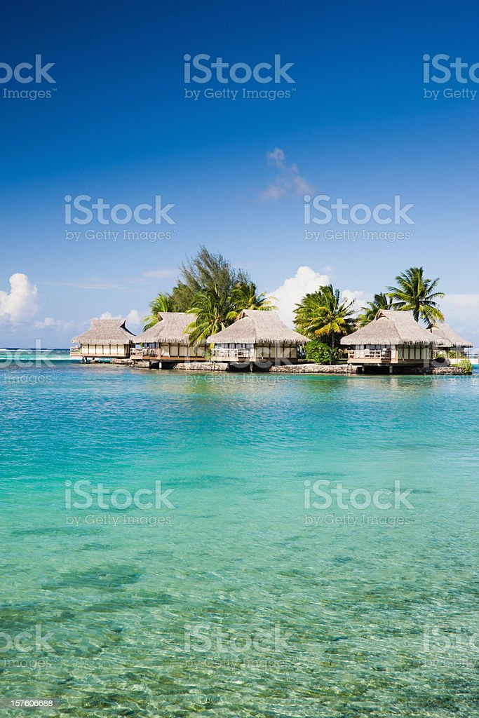 Holiday Hotel Cottages in Paradise Lagoon royalty-free stock photo