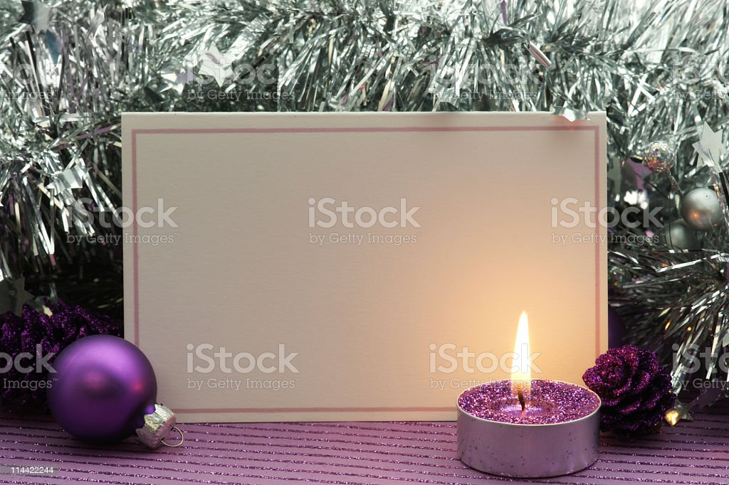 Holiday invitation with purple and silver decoration stock photo