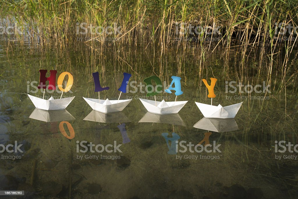 Holiday letters on white paper boats royalty-free stock photo