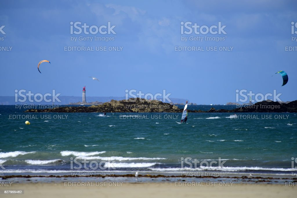 Holiday makers and locals enjoy the many beach activities to be had along St. Malo's famous beachfront; Le Sillon. stock photo