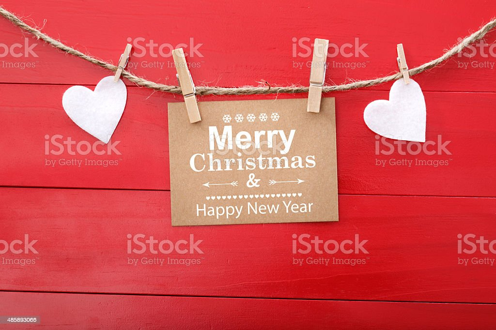Holiday message with felt hearts and clothespins stock photo