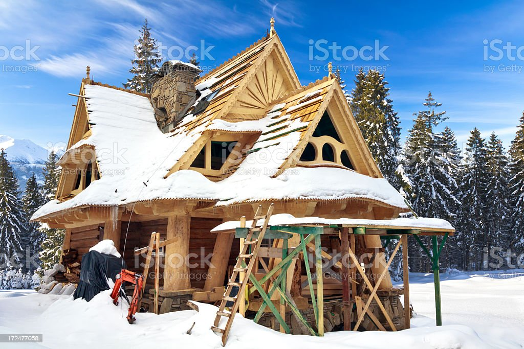 Holiday mountain cottage under construction royalty-free stock photo