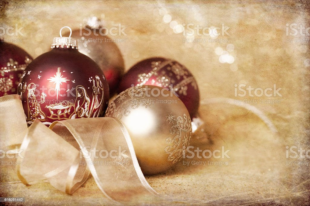 Holiday Nativity Christmas red and gold ornament baubles and rib stock photo