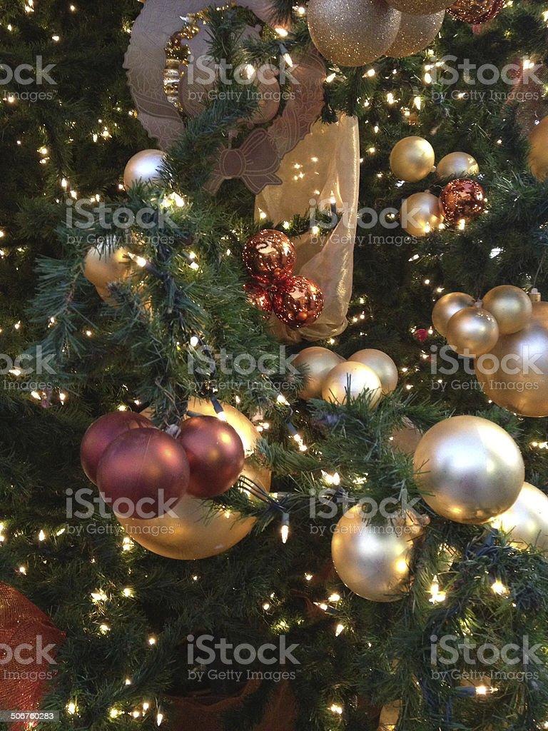 Holiday ornaments on Christmas tree stock photo