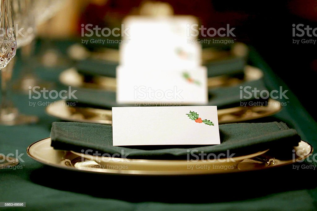 Holiday place settings with green napkins stock photo