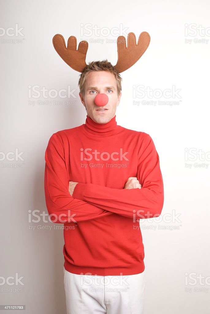Holiday Portrait of Serious Red-Nosed Reindeer Man stock photo