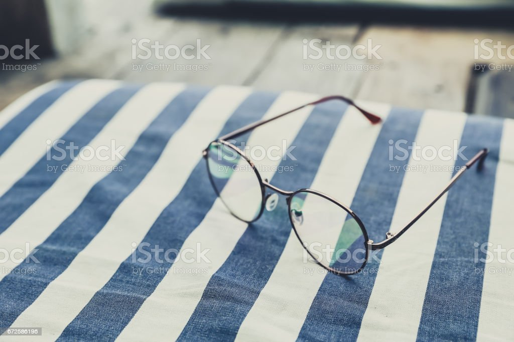Holiday relax from work concept. Eye ware Glasses vintage color tone stock photo