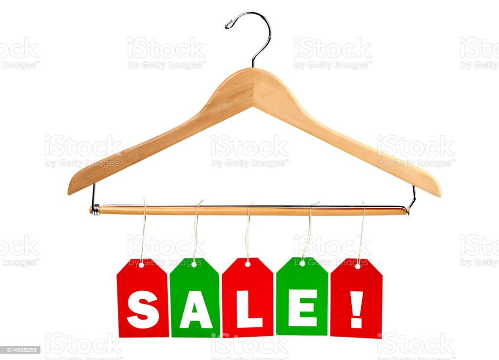 Holiday SALE tags on a clothes hanger stock photo