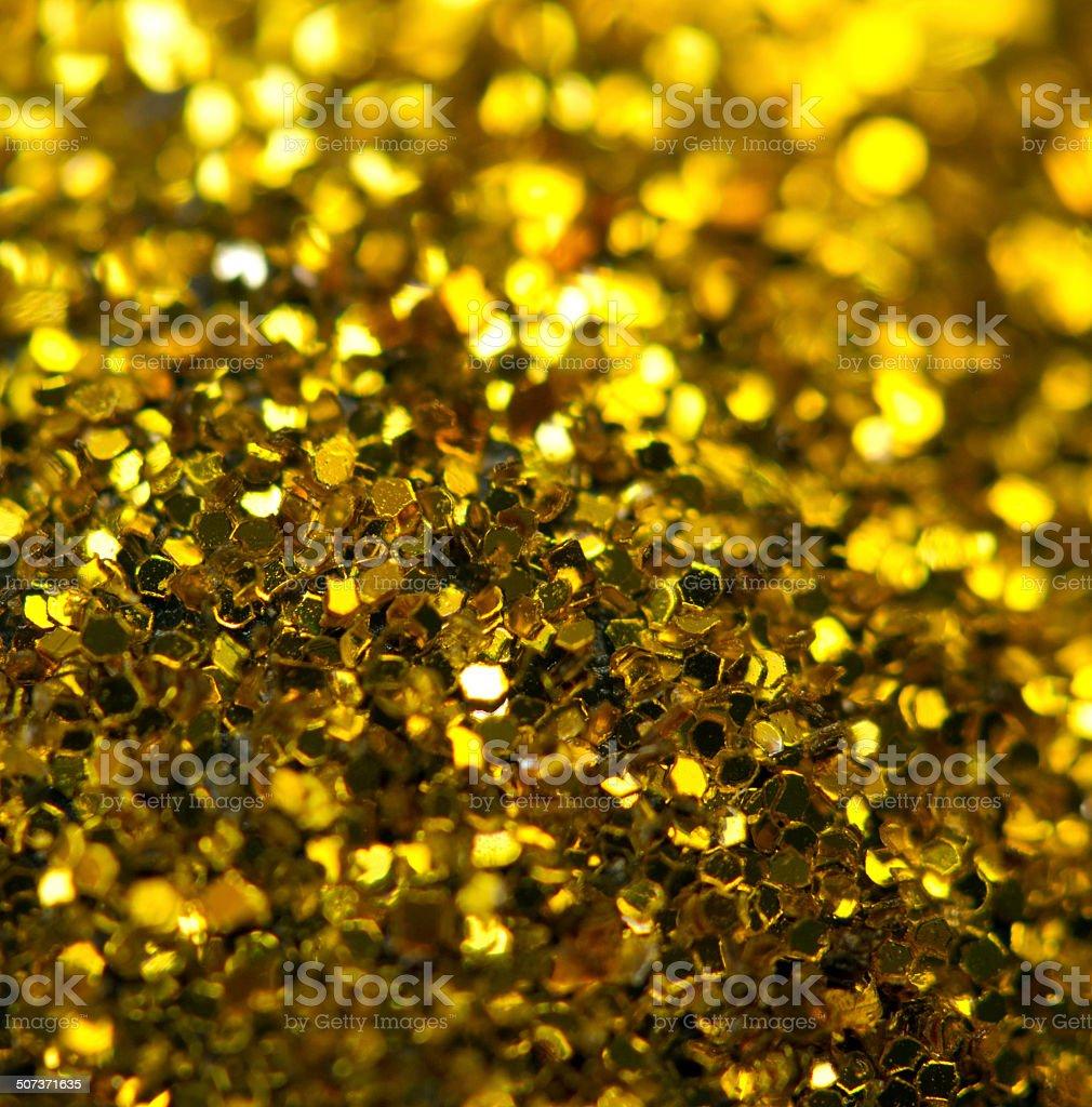 Holiday shiny blurry golden background. Macro stock photo