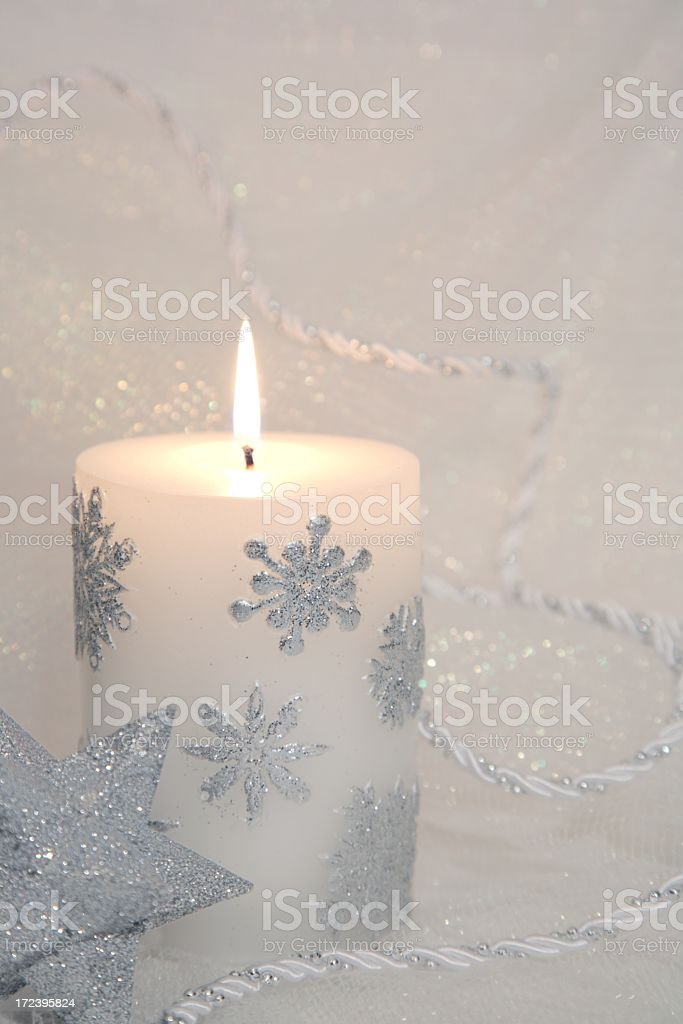 Holiday: Silver & White Candle with sparkling snowflakes royalty-free stock photo