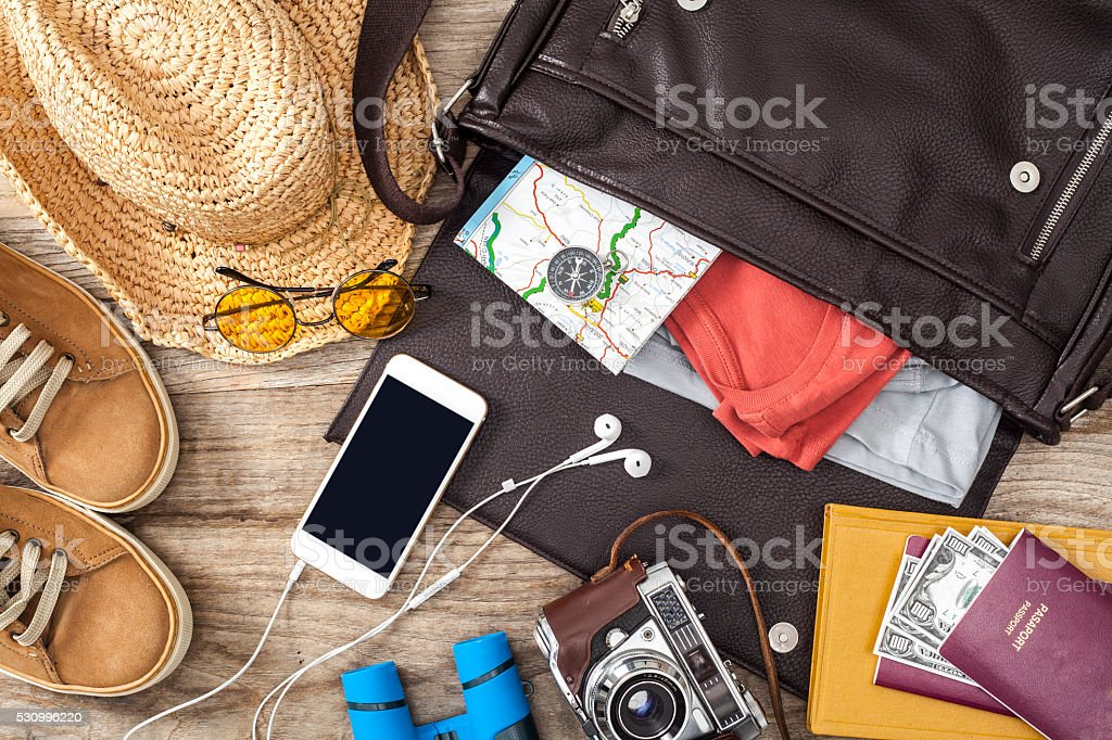 Holiday suitcase on wooden table stock photo