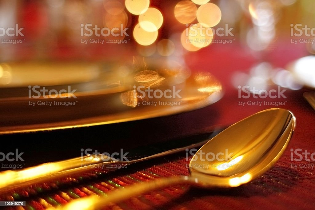 Holiday Table Setting: Defocused Christmas Lights in Background royalty-free stock photo