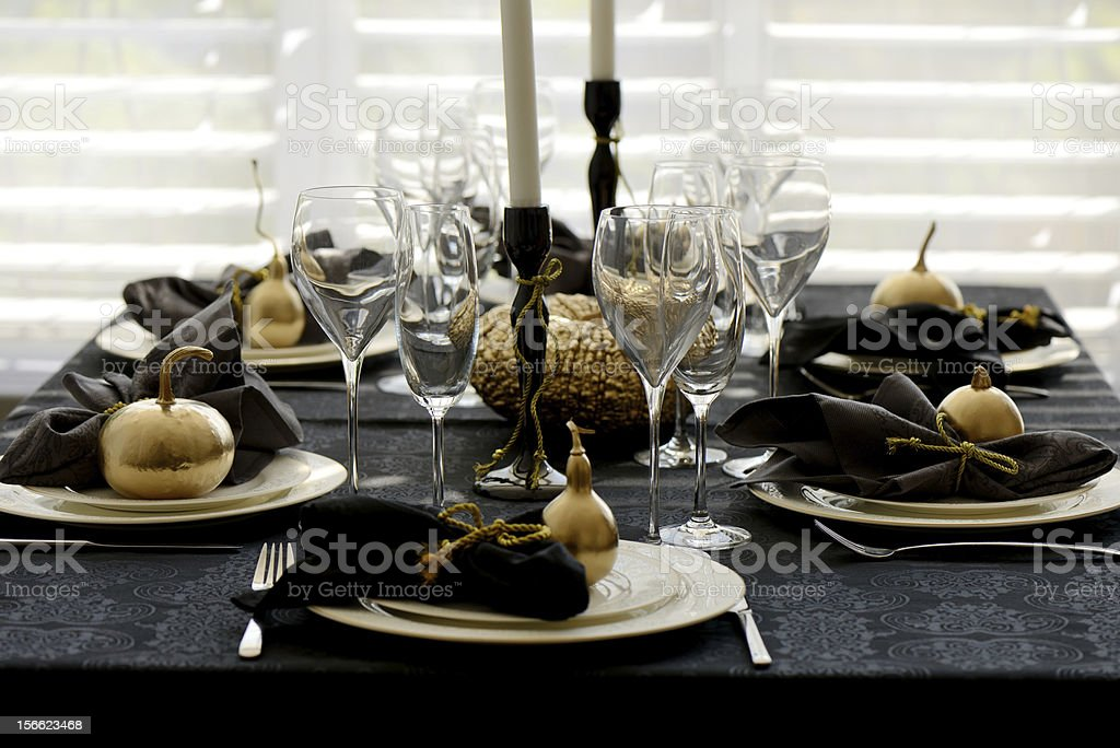 Holiday table setting with gold pumpkins stock photo