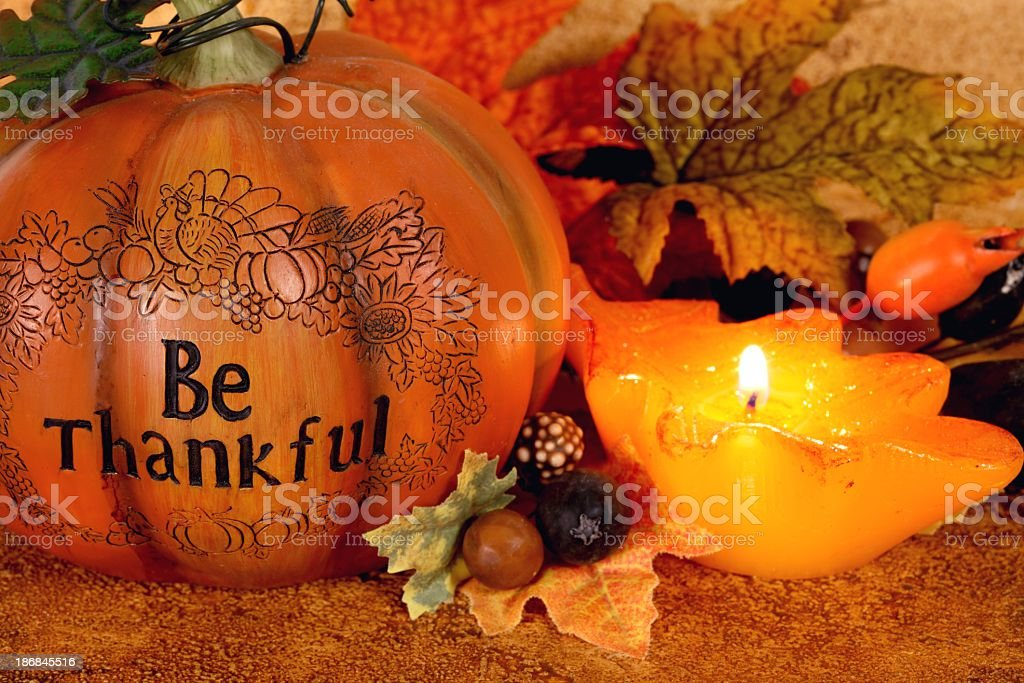 Thanksgiving still life with \'Be Thanksful\' on orange pumpkin and...