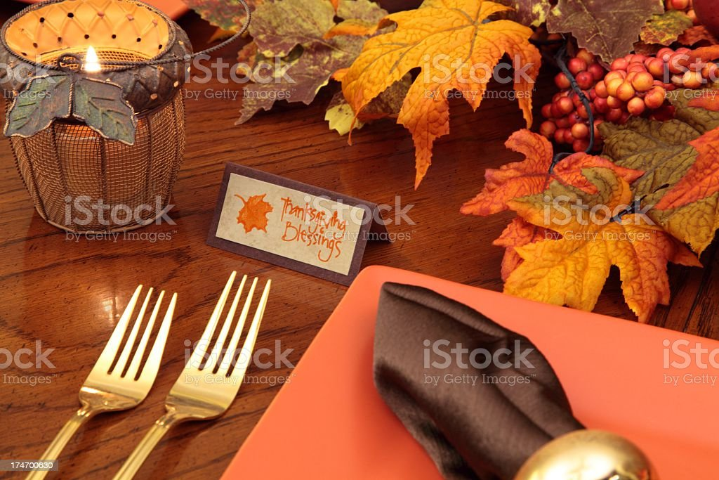 Holiday table in autumn colors with card that says Thanksgiving...