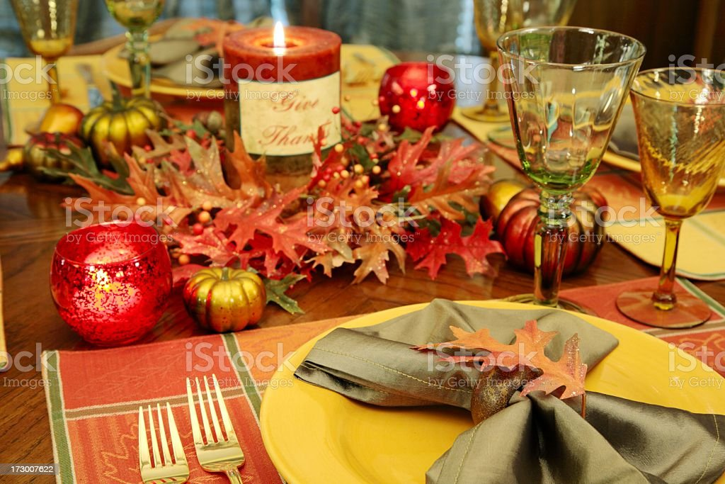 thanksgiving table or place setting done with autumn colored plates,...