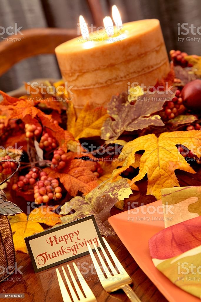 Thanksgiving Holiday table setting with autumn colored plate, leaves,...