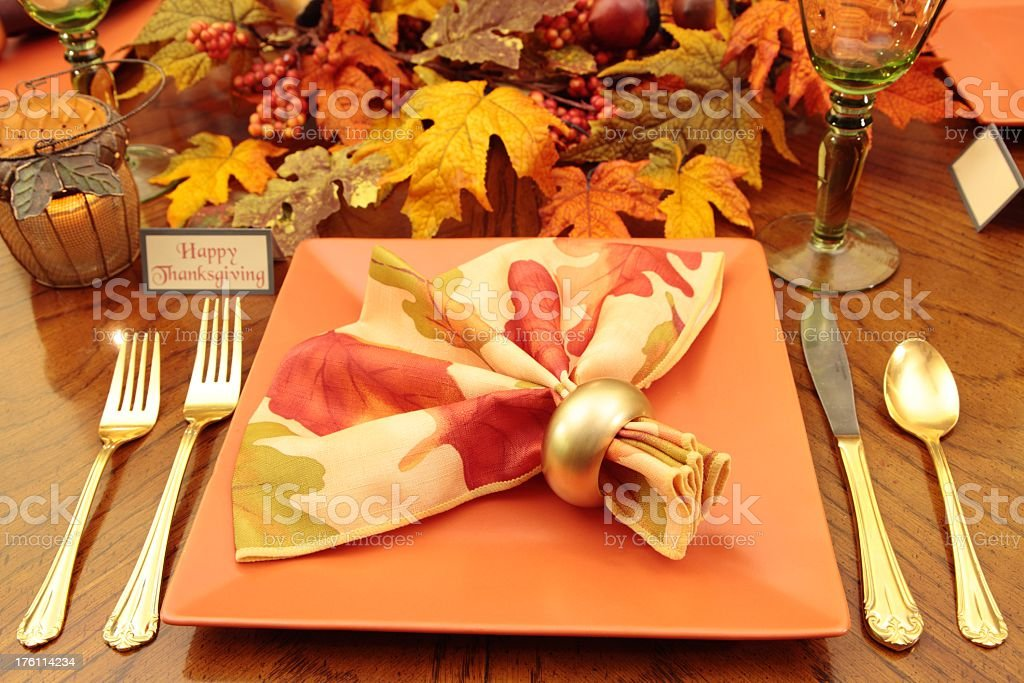 Holiday or thanksgiving table setting I n autumn colors including...