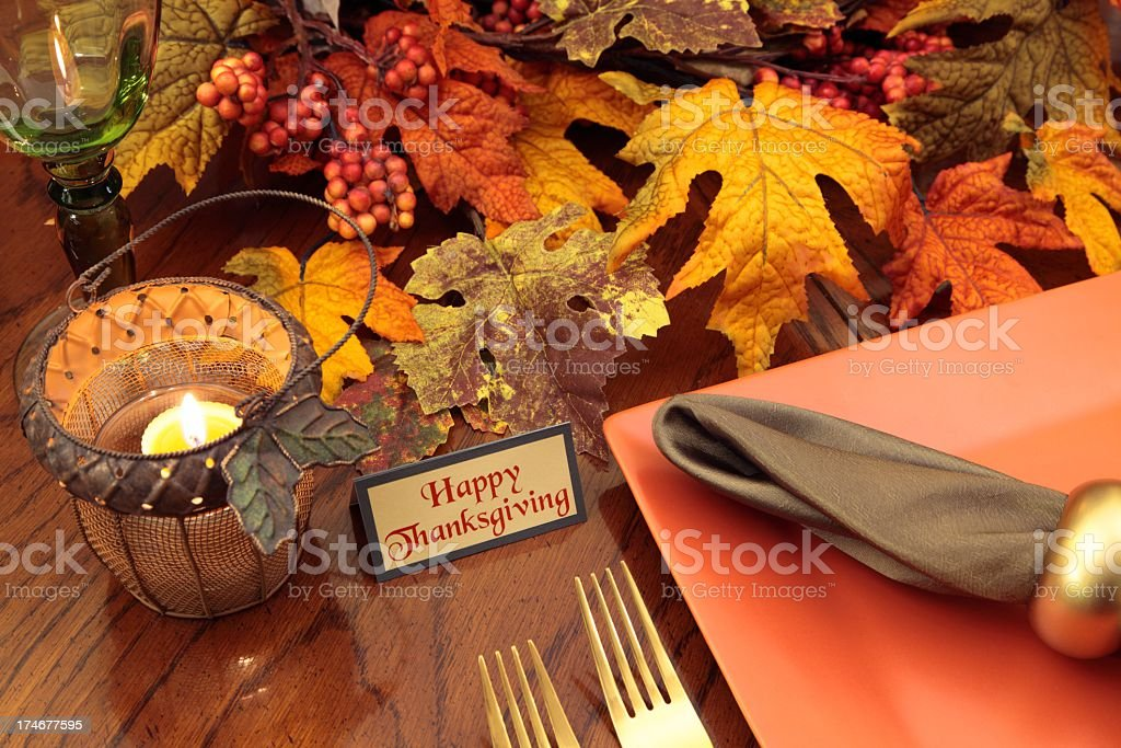 Happy thanksgiving place setting with happy thanksgiving written on...