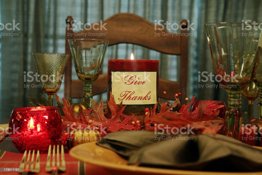 Holiday: Thanksgiving Table with place setting and candle royalty-free stock photo