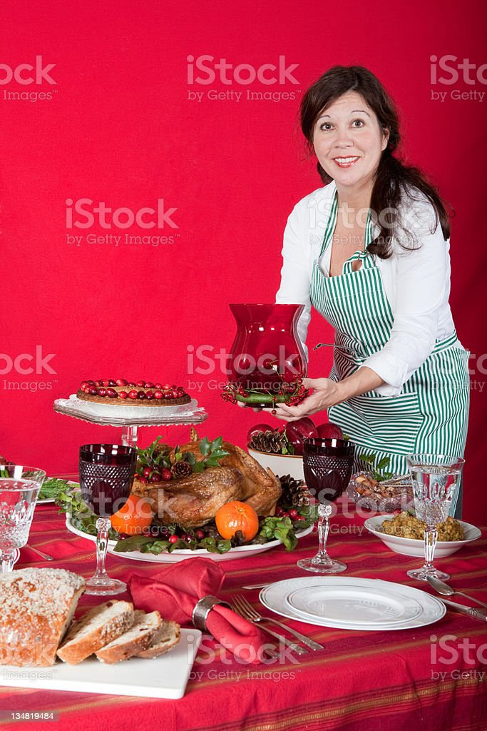 holiday turkey dinner and woman stock photo