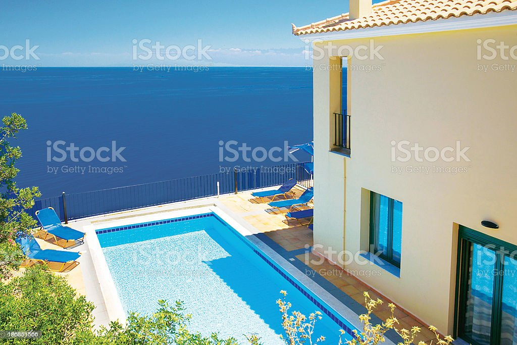 Holiday vacation villa and swimming pool royalty-free stock photo