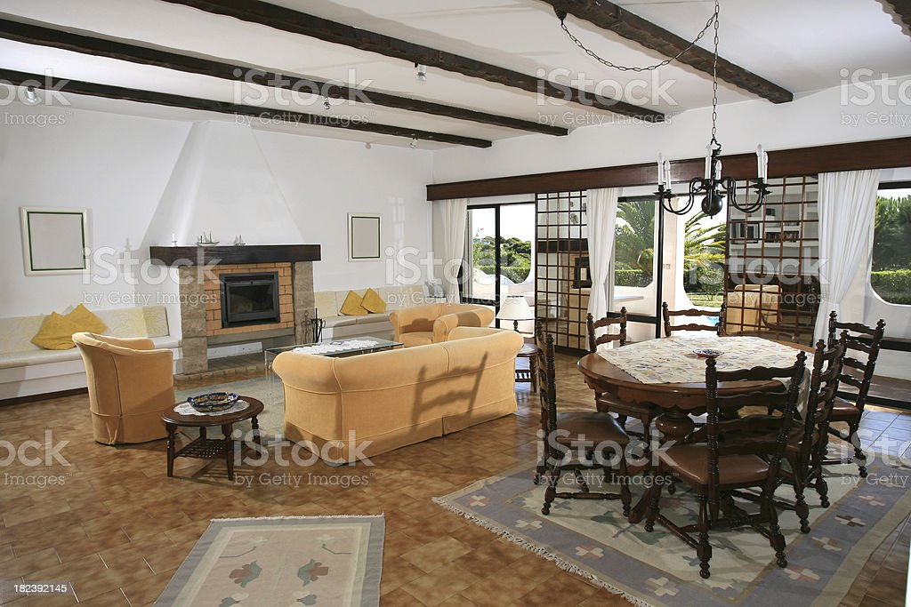 Holiday vacation villa lounge with furnitureand door to garden royalty-free stock photo