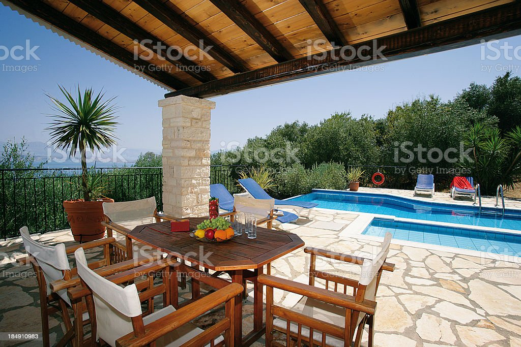 Holiday vacation villa with an infinity swimming pool royalty-free stock photo