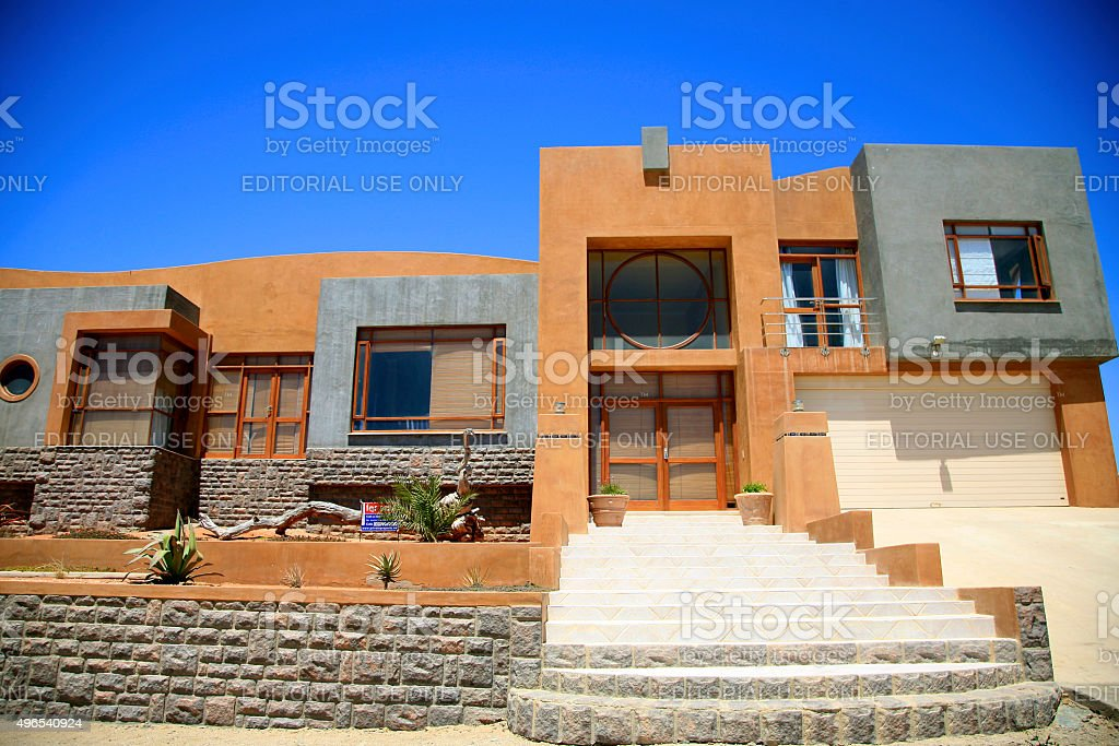 Holiday Villa with blue sky on sale, Luderitz stock photo