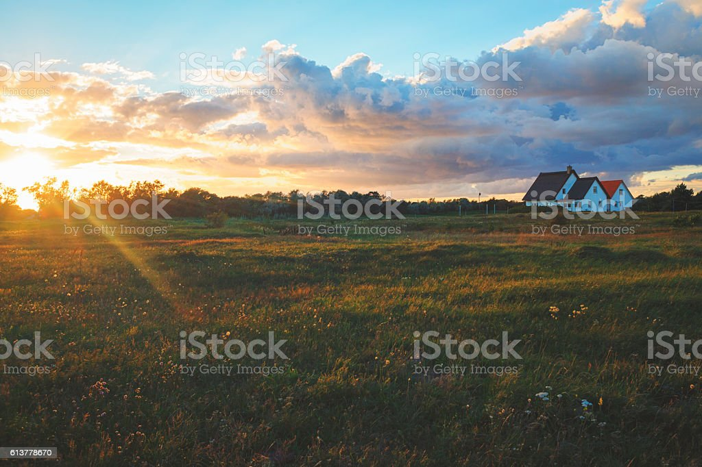 Holiday village at the Baltic Sea with big dramatic cloud stock photo
