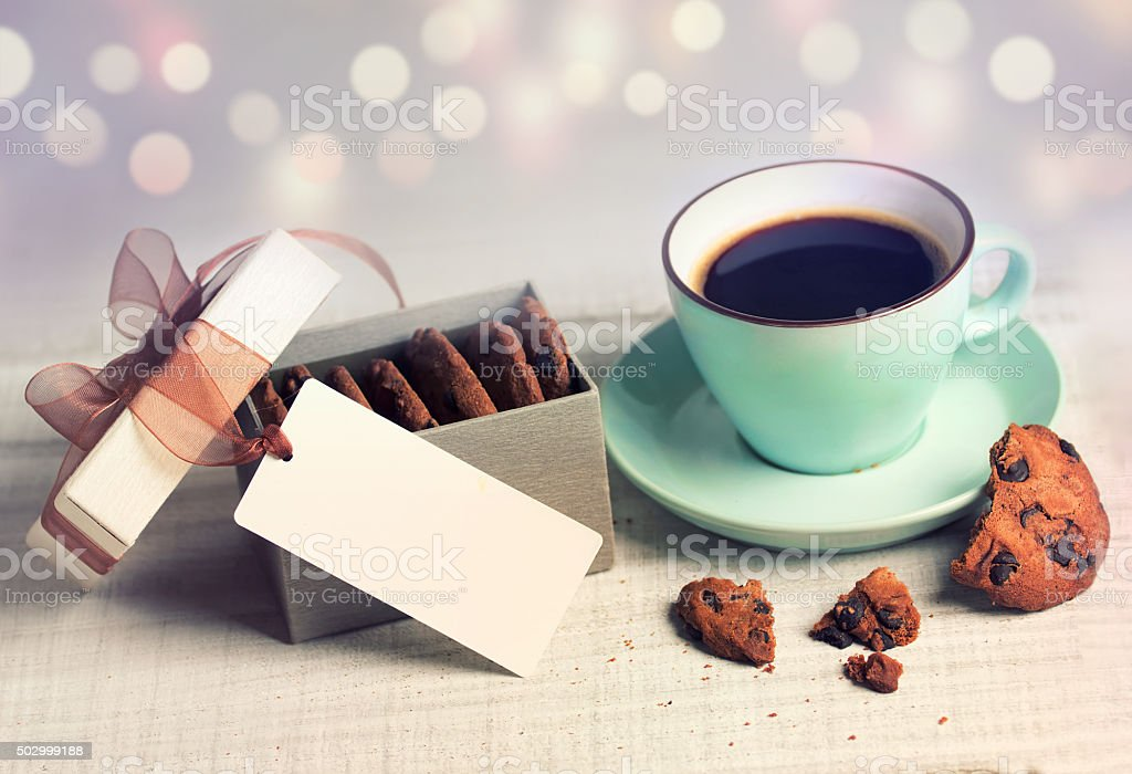 Holiday vintage hot drink coffee & cookies on blur background. stock photo