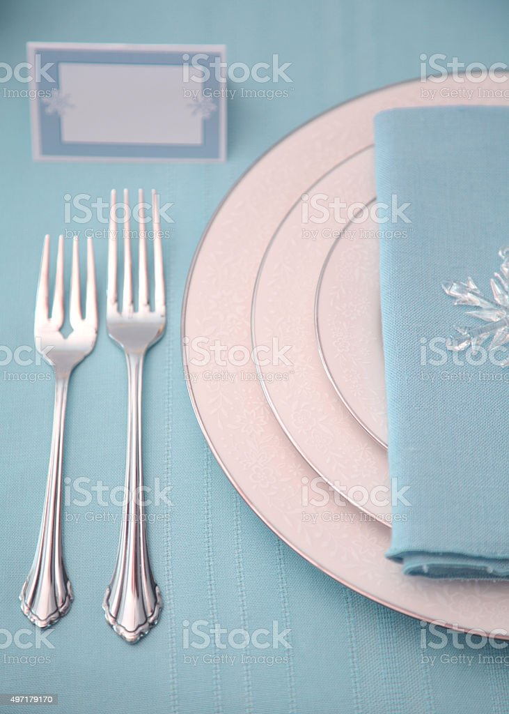 Holiday: Winter Table Setting in turquoise or aqua and silver stock photo