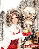 Holiday Wishes For Everyone - Woman Feeding Horse An Apple