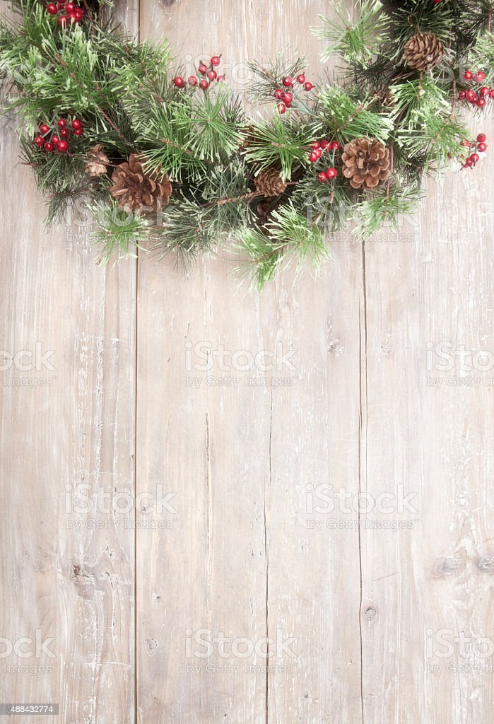 Holiday wreath hanging on old wood door stock photo