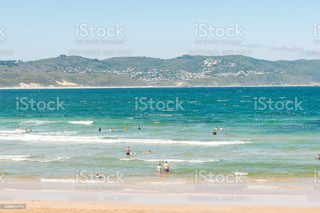 Holiday-makers and surfers at Buffelsbaai stock photo