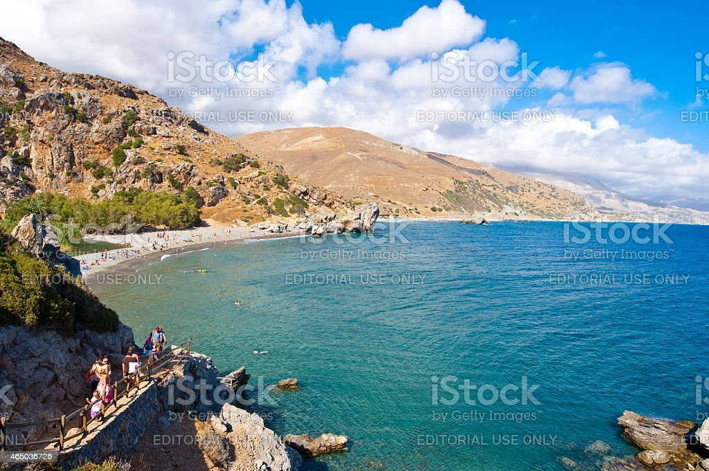 Holidaymakers go down the steps to the Preveli Beach. Crete. stock photo