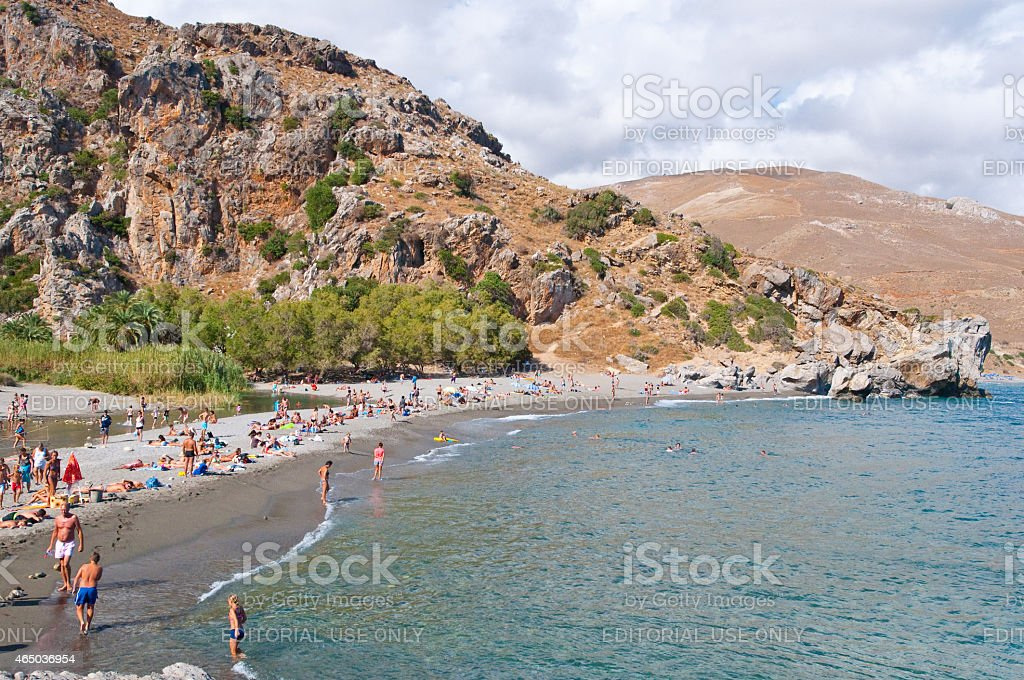 Holidaymakers on the Preveli Beach. Crete, Greece. stock photo