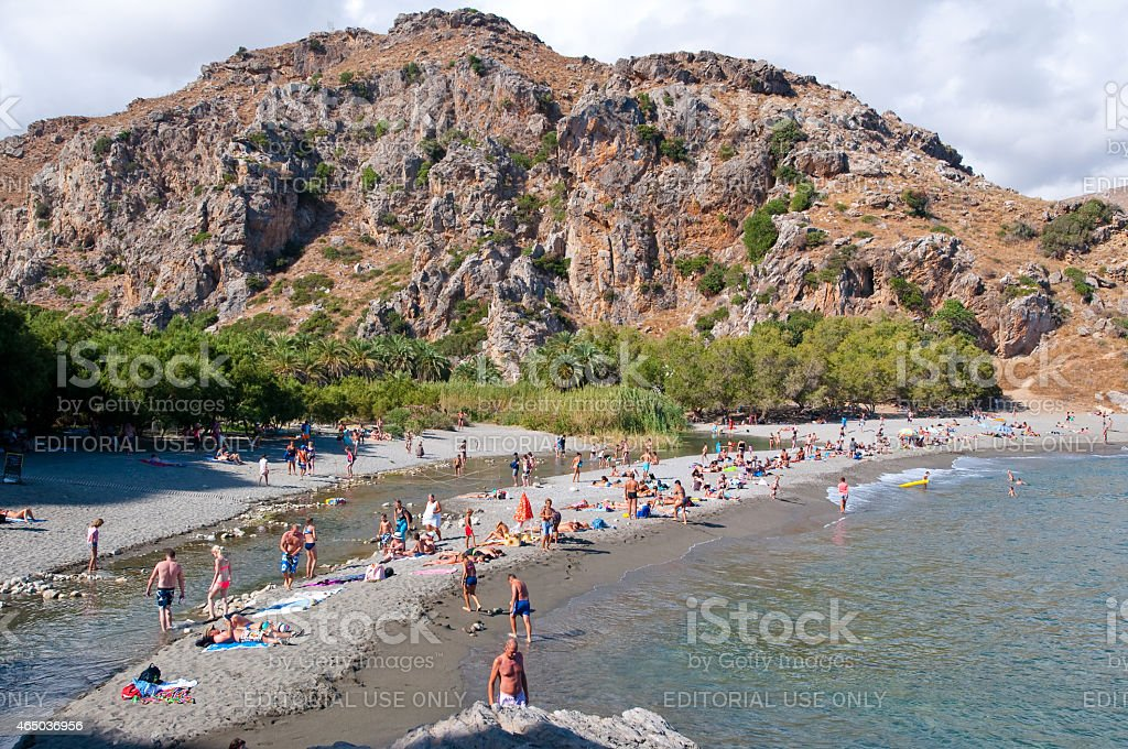 Holidaymakers on the Preveli Beach. Crete in Greece. stock photo