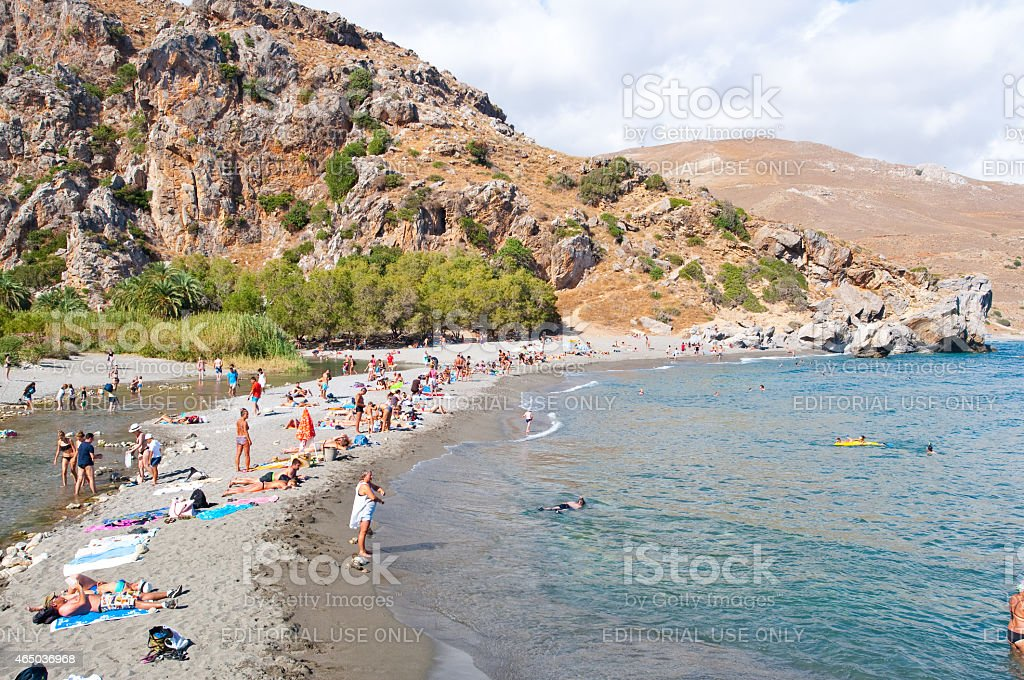 Holidaymakers on the Preveli Beach Crete island, Greece. stock photo