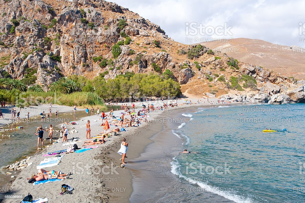 Holidaymakers on the Preveli Beach on Crete, Greece. stock photo