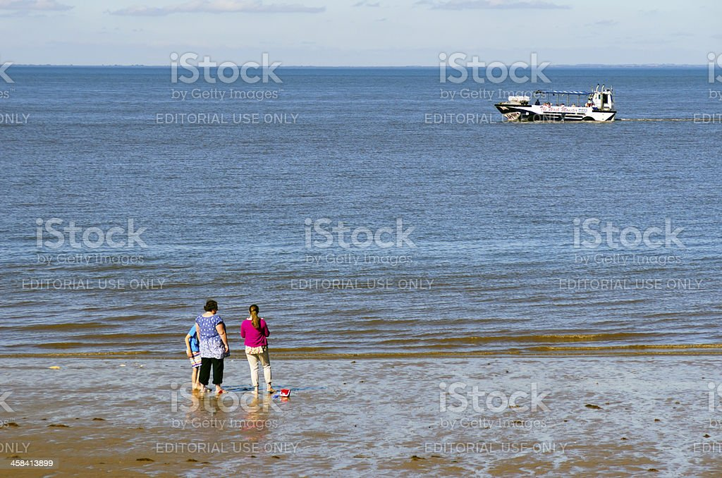 Holidaymakers watching the Wash Monster stock photo