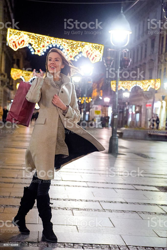 holidays and christmas  concept, woman walking with shopping bag stock photo