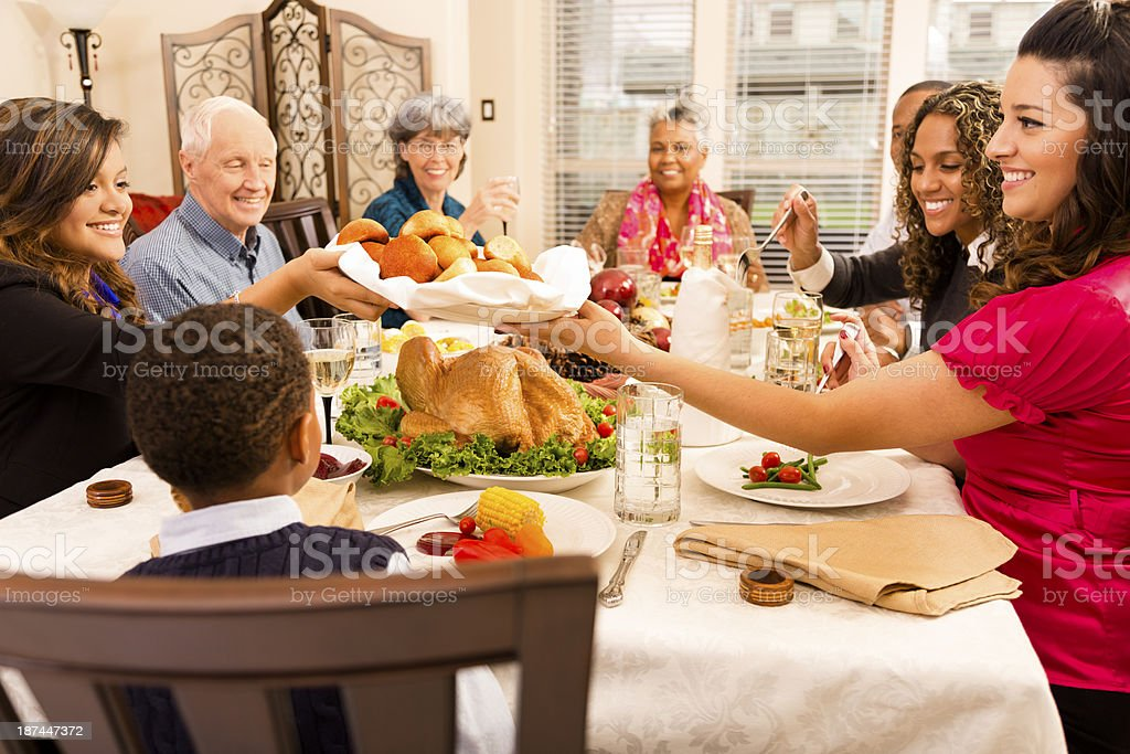 Holidays: Family, friends gather for dinner at senior woman's home. stock photo