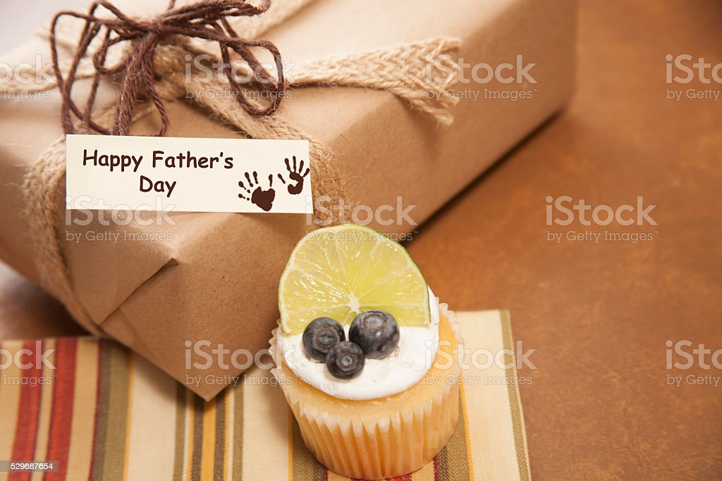 Holidays:  Father's Day wrapped gift for dad.  Breakfast muffin. stock photo
