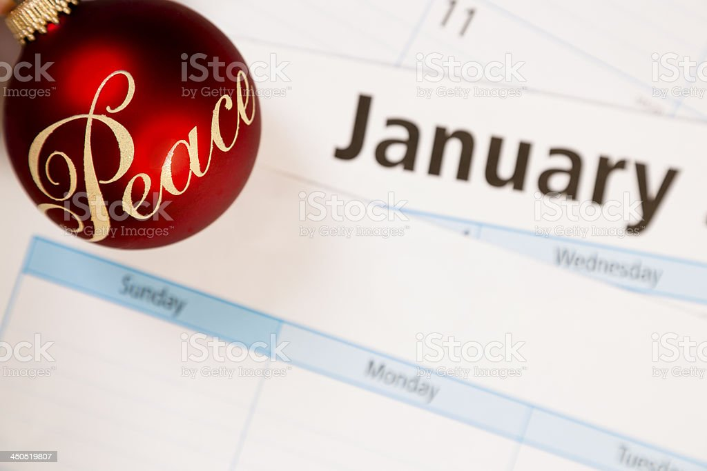 Holidays:  January calendar with 'Peace' ornament. Symbol. royalty-free stock photo